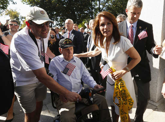 Michele Bachmann greets vets at the World War Two Memorial on the second day of the government shutdown in Washington