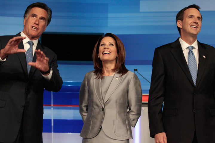 AMES, IA - AUGUST 11:  Republican presidential candidates (L-R) former Massachusetts Governor Mitt Romney, Rep. Michele Bachmann (R-MN) and former Minnesota Governor Tim Pawlenty take the stage for a debate in the Stephens Auditorium at Iowa State University August 11, 2011 in Ames, Iowa. This is the first Republican presidential debate in the state ahead of Saturday's all important Iowa Straw Poll.  (Photo by Chip Somodevilla/Getty Images)